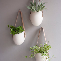 Set of 3 Porcelain and Leather Hanging Containers by Fashioned By - I feel like these beauties don't need any explanation. I thrive and work better when there are live greens around. Plus, the white ceramic, natural leather and live greens make perfection to me. I would hang these babies in my studio.