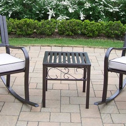 Oakland Living - 3-Pc Outdoor Rocker Set - Includes end table, two rocking chairs with cushions. Durable tubular iron construction. Metal hardware. Lightweight, fade, chip and crack resistant. Warranty: One year limited. Hammer tone bronze hardened powder coat finish for years of beauty. Minimal assembly required. Rocker chair: 23 in. W x 21.5 in. D x 34 in. H (33 lbs.). End table: 18 in. W x 18 in. D x 19 in. H (12 lbs.)The Oakland Rochester Collection combines practical designs and modern style giving you a rich addition to any outdoor setting. The traditional straight pattern work is crisp and stylish. Each piece is hand cast and finished for the highest quality possible. This rocker set will be a beautiful addition to your patio, balcony or outdoor entertainment area. Our rocking sets are perfect for any small space or to accent a larger space.