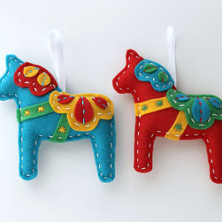 Dala Horse Felt Ornaments by Lova Revolutionary - These ornaments are sublime. You can use them as place settings or throughout your home for pops of color.