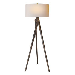 Tripod Floor Lamp - A chic tripod floor lamp is the perfect lighting solution for a sophisticated living room or home office. Choose between a natural or rich brown finish for a classic look. An elegant natural paper shade completes the effortless design.