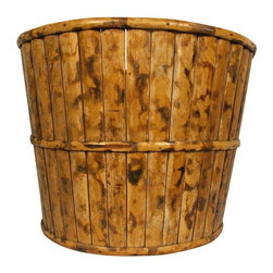Used English Tortoise Bamboo Basket - A very versatile English Bamboo basket that could easily be used to hold a plant, magazines, firewood, or more. The baskets diameter at the top is 19 inches, and 15 inches at the bottom, and it is in excellent vintage condition.