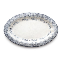 Arte Italica - Burano Oval Platter - Just the right size for your roast chicken or filet of fish or steak, you'll use this platter all the time. Part of the Burano dinnerware collection, this warm, white ceramic platter has a navy blue, lace-inspired border with uneven edges, lending it a vintage look.