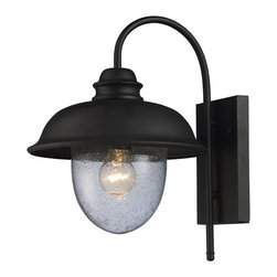 Elk Lighting - Elk Lighting Streetside Cafe Traditional Outdoor Wall Sconce X-1-00026 - This Elk Lighting Streetside Cafe Traditional Outdoor Wall Sconce truly captures the charm of an outdoor, cafe lantern. You will surely notice the rectangular back plate, gently curved arm and shapely hood in a matte black finish and heavy, seeded blown glass diffuser. It's a wonderful piece with an authentic, Old World style.