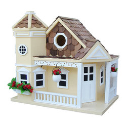 Home Bazaar - Yellow Sea Cliff Cottage Birdhouse - This exquisite birdhouse invites feathered friends to enter through the side into an unpainted nest box fully equipped with ventilation and proper drainage holes. It features classic pine shingles and an outdoor, water-based nontoxic paint that poses absolutely no risk to wildlife. A convenient swing-up paddle board allows for easy hanging, and a removable back wall makes cleaning simple.   9'' W x 10'' H x 9'' D Entry hole: 1.25'' diameter Exterior grade plyboard / kiln-dried hardwood / pine / polyresin Water-based nontoxic paint Spray clean Imported