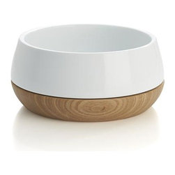 Hot Dips Bowl - White porcelain bowl makes a clean connection with its solid wood base, seamlessly integrating form and function in Ana-Reza Hadden's contemporary and practical design. Bowl heats up hot dips easily in the microwave or oven, while wooden base insulates and protects table surfaces.