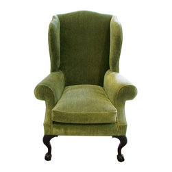 English Georgian America - George II Wing Chair - A carved mahogany wing arm chair, in the manner of the period circa 1740. The design of this chair, particularly the acanthus carved leg, terminating in a claw and ball foot, is typical as an example of the solid yet elegant seating furniture of the George II period.