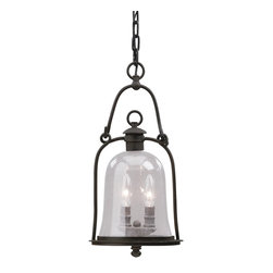 "Troy - Owings Mill Collection 18"" High Outdoor Hanging Light - From the Owings Mill lighting collection this outdoor hanging light shines with a relaxed and appealing style. It features hand-forged iron with clear seeded glass for a bright light throw. Natural bronze finish. Takes two 60 watt bulbs (not included). 18"" high. 8 3/4"" wide.  Natural bronze finish.  Takes two 60 watt bulbs (not included).  18"" high.   8 3/4"" wide."