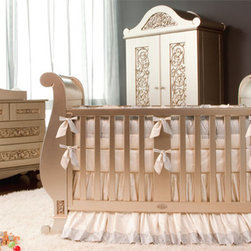 Chelsea Silver:  Sublime Sophistication - Hello glamor puss! Chelsea sleigh in silver is the ultimate in haute design for baby. The beautiful hand rubbed finish creates depths and hues that will dazzle! It's gorgeous relief carvings and sophisticated details create a look of stunning beauty. Thin slits on the end pickets of the front and back gate allow for place to tie your bumper, creating a seamless look. Designer Stephen Bauer's interpretation of the classic sleigh crib is the pinnacle of design, quality, and Victorian elegance.