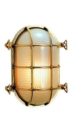 """Weems & Plath Oval Brass Bulkhead Light - This classic brass bulkhead light can use up to a 60w electric bulb and mounts with two screws. The frosted glass lens is protected by a brass framework which is rugged enough for an engine room but rich looking enough for the main salon. It can also be overhead mounted. It's dimensions are: 5.38"""" wide x 7.63"""" long x 4.38"""" deep. The light source is 110v electric and a 60 watt max. lightbulb is included. It weighs 5 lbs. 12oz. The distinctive style, quality, timeless design and lasting beauty of this light will enhance the decor of any home or ship's cabin. If you want a modern light with distinctive antique flavor then look no further."""