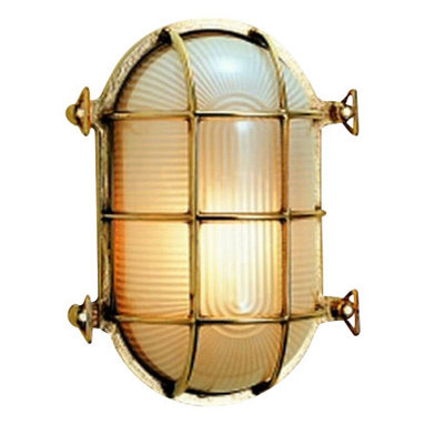 "Weems & Plath Oval Brass Bulkhead Light - This classic brass bulkhead light can use up to a 60w electric bulb and mounts with two screws. The frosted glass lens is protected by a brass framework which is rugged enough for an engine room but rich looking enough for the main salon. It can also be overhead mounted. It's dimensions are: 5.38"" wide x 7.63"" long x 4.38"" deep. The light source is 110v electric and a 60 watt max. lightbulb is included. It weighs 5 lbs. 12oz. The distinctive style, quality, timeless design and lasting beauty of this light will enhance the decor of any home or ship's cabin. If you want a modern light with distinctive antique flavor then look no further."