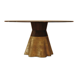 Tavola 9 - This cast bronze, wood, and glass table is a design collaboration between the Costantini founders. The conical base is visually softened to evoke the waves of a dress. Their first showpiece to debut at the Milan Furniture Fair.
