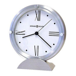 Howard Miller - Simon Contemporary Table Clock w Brushed Alum - The Simon table clock combines art deco flair with modern design for an eye-catching effect. Its brushed aluminum casing is accented with three polished silver toned buttons, while the white face is marked with classic Roman numerals and rectangular hands. * Brushed aluminum clock features a flat glass crystal accented with 3 polished silver-tone buttons and set in a brushed and polished aluminum semi-circle baseWhitedial with black Roman numerals and square hour markersQuartz,movement includes the battery6.25 in. H x 5.5 in. W x 2.25 in. D