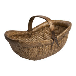 Vintage Farmer's Basket - The original of this rustic basket was used by farmers in China more than 100 years ago to carry fruits, vegetables, or flowers to and from the market. Our basket's tightly woven wicker and straw is quite sturdy and makes a beautiful home for magazines or fireplace kindling. Its generous size also makes it a perfect picnic basket. The color varies from a light brown to light tan with hints of red. Sizes and color will vary.