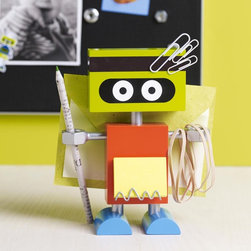 Robots! - Science has promised that in the future robots will do all the work. Why wait? Our robot is ready to assist you now. He holds pens or pencils, paper clips, notes and mail. He never gets tired. Never takes a day off. Never complains. And he won't try to replace you, either. Made of painted MDF with metal and flex magnet accents.