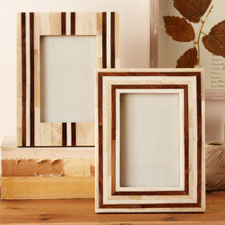 "Two's Company - Striped Bone & Wood Inlay 4x6 Photo Frame - This inlay picture frame set enriches interiors with natural and modern flair. Compeling in ivory bone, the photo accessory delivers intrigue with rustic wood stripes. Frame: 7""W x 9.5""H; Photo: 4""W x 6""H; Sold individually; Select from two styles; Bone and Sheesham wood"