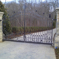 AJ gate and ironwork - approximately 16' x 10' automatic drive gates. hand forged components all solid stock. Adapted from an existing set of gates at the former residence. Installed with stainless bearing hinges and automated. All powdercoated in an antique bronze.