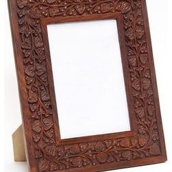 Sitara Collections - Carved Mango Wood Photo Frame - As Beautiful as the Memory You Want to Preserve, this Elegant Frame is the Perfect Home for Treasured Pictures. Featuring an intricately Carved Botanical Motif and Rich, Classic Look, the Frame's Quality Craftsmanship Ensures It Will Be a Family Favorite for Years to Come. Outer Dimensioms: 10.5 inches High X 8.5 inches Wide inner Dimensioms: 6.44 inches High X 4.375 inches Wide for Decorative use omly Due to Handcrafting, Slight Variatioms May Occur Wipe Clean with a Dry Cloth Setting: indoor Type: Photo Frame Colors: Brown Materials: Mango Wood.