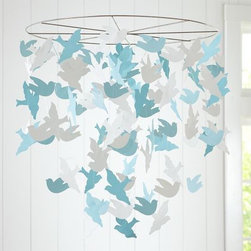 Bird Paper Mobile - This blue and white paper mobile with flying birds is so sweet and fun. The colors make it appear a bit more edgy, too.