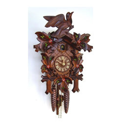 Schneider Cuckoo Clocks - 1-Day Traditional Hand Painted Flowers Cuckoo Clock - 1-day rack strike movement. Wooden cuckoo, dial with roman numerals and hand. Shut-off lever on left side of case, silences the strike, call and music. Made from wood. Made in Germany. 7.87 in. W x 6.10 in. D x 12.20 in. H (5.51 lbs.). Care Instructions