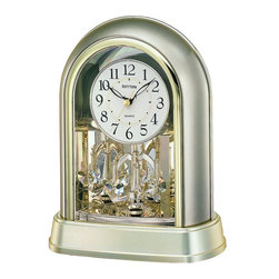 Rhythm Clocks - Crystal Mantel Clock Silver 4SG696WR18 - The brilliance of the Swarovski crystal pendulum is highlighted by the gold-mirrored interior. Clock is battery operated with a Quartz movement.