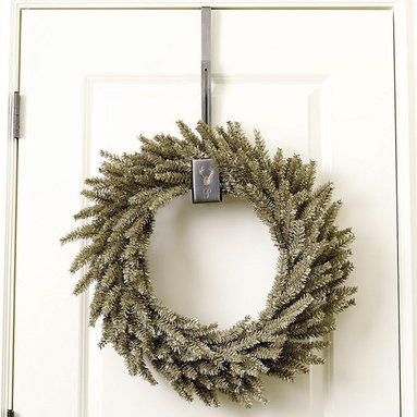 Ballard Designs - Suzanne Kasler Antler Wreath Hanger - Raised antler details. Stainless steel & brass. Suzanne Kasler designed this handsome Antler Wreath Hanger so you can display your wreath without damaging your door. The sturdy hooked arm hangs over the top of the door and adjusts in length with matching screws. Customize it with a single letter monogram.Suzanne Kasler Wreath Hanger features: . . *Monogramming available for an additional charge.*Allow 3 to 5 days for monogramming plus shipping time.*Please note that personalized items are non-returnable