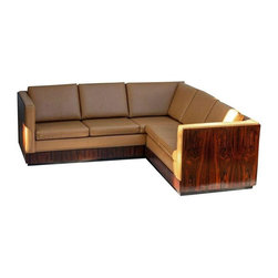 "Used Milo Baughman Rosewood Wrapped Sectional - This piece is a stunning and rare find! While it's hard to find Milo Baughman Rosewood wrapped sofas, it's nearly impossible to find his rosewood wrapped sectionals. The piece is in excellent vintage condition with minimal condition issues.     The seller says: ""The sofa is upholstered in a butterscotch vinyl and had a few nicks on the top back of the vinyl which I have had professionally repaired, and they aren't very noticeable. There are minor chips and wear along the bottom to commensurate with the age of this wonderful piece.""    This piece would look fantastic in any loft or any open floor plan that could showcase the beauty of the sides and back of the sectional.    This piece is a left side sectional that measures 90"" L on long side x 84"" L on shorter side x 30"" T x 34.5"" D."