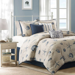 Madison Park - Madison Park Bayside 7 Piece Comforter Set - Create a coastal getaway right in your bedroom with the Bayside Comforter Collection. Made from 200 thread count cotton sateen, the comforter and shams feature assorted seashells accentuated with light and dark blue coloring on an ivory baackground. In a deep taupe color, a coral motif is printed on the background to give another dimension to this pattern. The reverse of both the comforter and shams is the same corresponding dark blue from the face. Three decorative pillows use pleating and embroidery details for added value to this collection. Comforter & Sham: 100% cotton 200TC sateen printed on face, 180TC cross weavebacking, 270g/m2 poly fill Bedskirt: 180TC cross weave Pillow: 180TC cotton cross weave cover and poly filling