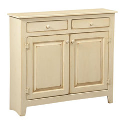 Chelsea Home Furniture - Chelsea Home Hannah Large Cabinet - This free-standing 36-inch high 41-inch wide Hannah Large cabinet with 2 cabinet doors and 2 top drawers lightens up any space. Shown in a distressed Buttermilk stain in sturdy Eastern White Pine, this austere cabinet with beautiful wooden knobs is perfect for foyers or entryways of your home, welcoming guests with a simplistic flair. Chelsea Home Furniture proudly offers handcrafted American made heirloom quality furniture, custom made for you. What makes heirloom quality furniture? It's knowing how to turn a house into a home. It's clean lines, ingenuity and impeccable construction derived from solid woods, not veneers or printed finishes over composites or wood products _ the best nature has to offer. It's creating memories. It's ensuring the furniture you buy today will still be the same 100 years from now! Every piece of furniture in our collection is built by expert furniture artisans with a standard of superiority that is unmatched by mass-produced composite materials imported from Asia or produced domestically. This rare standard is evident through our use of the finest materials available, such as locally grown hardwoods of many varieties, and pine, which make our products durable and long lasting. Many pieces are signed by the craftsman that produces them, as these artisans are proud of the work they do! These American made pieces are built with mastery, using mortise-and-tenon joints that have been used by woodworkers for thousands of years. In addition, our craftsmen use tongue-in-groove construction, and screws instead of nails during assembly and dovetailing _both painstaking techniques that are hard to come by in today's marketplace. And with a wide array of stains available, you can create an original piece of furniture that not only matches your living space, but your personality. So adorn your home with a piece of furniture that will be future history, an investment that will last a lifetime.