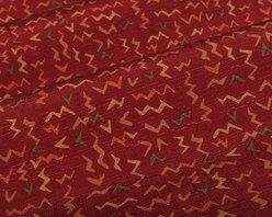 Zig Zag Pattern Fabric in Lipstick Red - Zig Zag Pattern Fabric in Lipstick Red is a fun confetti printed fabric on a red base the is suitable for light upholstery projects and accent pillows. This energizing fabric will have you in the mood for a fiesta every time you enter the room. 100% lyntex Width: 62″