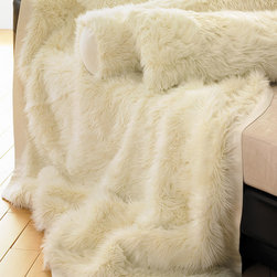 "Aura Throw - 48"" x 76"" - Practicality need not be predictable: The Aura Faux Fur Throw transforms the everyday, warm throw into an accent that's part glam and all beauty. The rich ivory coloration blends well with muted or monochromatic palettes, or presents a soothing contrast to more vibrant appurtenances. The throw's ample proportions allow for placement on a larger-size settee, chair, or window seat. 76"" x 48"""