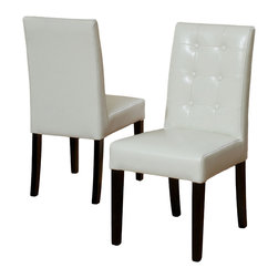 Great Deal Furniture - Gillian Ivory Leather Dining Chair (Set of 2) - Dine in style and elegance with the Gillian Leather Dining Chair . It features a tufted backrest, Upholstered in ivory bonded leather, and black stained legs.