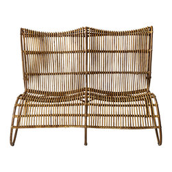 Bambeco Rattan Malacca Settee - From the hands of skilled Indonesian villagers to an honored place in your homethis charming settee weaves a lush story of ancient practices, shaping reed (Malacca) into works of art. At once sturdy and slender, your hand-woven settee conveys the perfect balance of form and function. And oh the comfort Note the meandering quality of back and seat, bent to perfection to cradle your body.  Pair with our BMF Chaise to create a profound sense of relaxed elegance in your dwelling.   Dimensions:   32H x 46W x 34D
