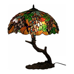 Warehouse of Tiffany - Oval Grape Lamp In Tree Base - Tiffany shade. Requires two 60W light bulbs. Light bulb not included. 2 Pull chain. Made of cut glass, cabochons and copper foil. Bronze finish. Minimal assembly required. 20 in. W x 25 in. HTiffany Style Oval Grape Lamp In Tree Base. The shade is made of individually cut glass and cabochons that is wrapped around with copper foil and soldered together.