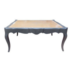 Antique Leather Top Coffee Table - Original leather top panels with gold floral design on the siding, and elegant curved legs. Reincarnated in black chalk paint, with a touch of hand distressing. The worn patina of this leather will definitely add character to your home.