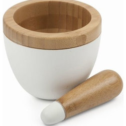 "The Ivory Company - Modern Mortar & Pestle - Intensify flavor by grinding whole spices, fresh herbs, garlic and more with this durable mortar and pestle. This snow white colored bamboo mortar and pestle blends old-world kitchen prep with modern aesthetic. Artfully hand crafted of 100% organically grown bamboo. Wash with warm soapy water and dry.Measures 5""dia. x 5.1""HColor:"