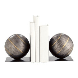 Arteriors - Gauge Bookends Pair - Spheres are a unique and charming shape for bookends, adding an intriguing visual contrast to your tall, straight books. These spherical bookends are designed to enhance that contrast, with diagonal brass-welded stripes pointing toward the corners of the L-shaped brackets, as if the globes were leaning at right angles. The natural, pocked iron has an earthy look that complements the globe shape.