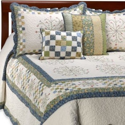 Nostalgia Home - Emily Bedspread - This beautifully hand-crafted bedspread combines postage stamp piecing and embroidery in an updated traditional layout of soft blues and yellows.