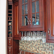 Traditional Home Bar by Caves Kitchens