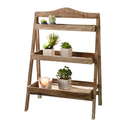 Pier Surplus - Foldable Wooden Plant Stand for Outdoor or Greenhouse, Three Shelves #GD221582 - Made for outdoor use, this wooden plant stand features three shelves which will artfully display your potted plants. Try placing it in a sunny corner to grow vegetable starts for your summer garden. Its stable bottom means it will not tip over, and can even straddle uneven ground to securely showcase beautiful plants. This wooden plant stand is perfect for friends who love to garden or people who entertain outdoors.