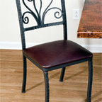 Mathews & Company - Alexander Dining Side Chair - Straight lines, subtle curves and ornate scrollwork combine to create a classic chair with a unique twist. The gentle curve of the back and plush padding of the seat make for a relaxing, comfortable chair. And the carefully padded feet will protect your floor. Whether you choose the aged pewter finish combined with a cloth seat, or perhaps the timeless natural black iron with brown leather, or any other combination you can think of, this is sure to be a welcomed addition to your kitchen, dining room or patio. Pictured in Leather upholstery and Black finish.