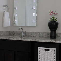 Lighted Image - LED Illuminated Mirror - Lighted Image presents this modern and stylish illuminated bathroom mirror with LEDs clustered down each side. With a degree of sophistication, this LED bathroom mirror features a sensor switch that allows you to illuminate the LED mirror with the swipe of a hand and a de-mister to ensure your mirror stays crystal clear.