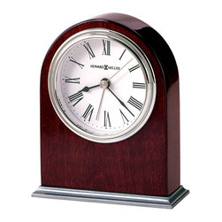 """Howard Miller - Nickel Finished Table Top Alarm Clock with Wh - Watch the hands on this clock redefine the hour. Halfmoon wooden finishes are accentuated by shiny stainless steel appointments. Roman numerals decorate the face of this selection reincorporates classic sophistication into contemporary design. * This table alarm clock is arched shaped and offers a nickel finished metal base. . The white dial features a polished nickel finished waterfall bezel, black numerals and hands, and silver second and alarm hands. . Finished in Rosewood Hall on select hardwoods and veneers. . Quartz, alarm movement includes battery. . H. 5-1/2"""" (13 cm). W. 4-1/4"""" (11 cm). D. 1-1/2"""" (4 cm)"""