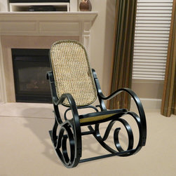 None - Alexandria Antique Black Finish Bentwood Rocker - The design of a Bentwood rocker fits well in today's ultra-modern designs. With its comfortable cane seat and back and elegant artist quality continues to make the Victoria Bentwood Rocker a popular rocker in many homes.