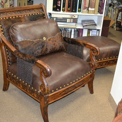 Leather Furniture - Leather and hair on hide make this chair and ottoman very unique with large nail trim and custom made fringe.