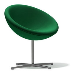 Vitra - Panton C1 Lounge Chair, Green Tonus Wool - Verner Panton's career as a designer first peaked at the end of the 1950's. With a series of furniture featuring basic geometrical shapes he pre-empted Pop Art ideas and yet with the base frames clearly adopted the elegance of Scandinavian Modernism. With the C1 armchair created around the same time, Verner Panton for the first time chose a section of a sphere. On swivel bearings and slightly tilted, the upholstered seat shell is astonishingly comfortable-both for relaxed sitting, leaning back and for upright sitting. The C1 can be integrated into private apartments, hotels or reception areas, cuts a fine figure in larger groups, and can be complimented by the matching stool.