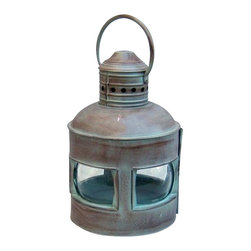"Handcrafted Model Ships - Antique Brass 4 Sided Rounded Lantern 14"" - Nautical Decor - Handmade from solid brass with a glass lamp enclosure, this antique brass 4 sided rounded oil lantern is built to the same specifications used to make the real lamps found in classic ships around the world. Designed specifically for lighting a ship's dark interiors, these lanterns had to be sturdy enough to withstand turbulent conditions on an active seafaring vessel while maximizing the amount of light created from its flame. Not only a wonderful addition to the nautical decor of an office, den or family room, this fully functional replica is suitable for actual use hanging in a patio or garden, or placement on an outdoor table."