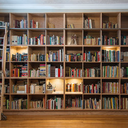 Built-in Wall Units - Custom-made built-in bookshelf with rolling library ladder.  Overall dimensions are 9' high by 14' wide.