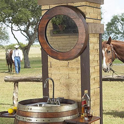 Barrel Mirror - This wooden Barrel Mirror is sure to bring out a Wild West atmosphere in your home. Made out of an antique wine barrel, it makes a great piece to add to a rustic decor scheme. Don't be afraid to get it dented or chipped, as this mirror is meant to look scuffed. The more wear and tear the better! I love how it's paired it with a matching wine barrel sink, another must-have for me.