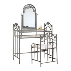 Coaster - 2-Piece Vanity Set (Nickel Bronze) By Coaster - Create your very own cosmetic corner with this Vanity Table Set by Coaster. This stylish personal table features a swiveling mirror and two glass shelves to hold a variety of products and accessories. Its real charm comes from the gorgeous leaf and vine motif fixed into the metal frame of the vanity. The stool is upholstered with faded flower square patterned fabric, and the metal frames of both table and stool are finished in nickel-bronze. Pamper yourself in style with this beautiful vanity table set by Coaster. Features: Nickel-bronze finish Faded flower square patterned fabric Made of durable metal Vine leaf motif Swivel mirror Two tempered glass shelves Includes Vanity and Stool Some assembly required Specifications: Vanity Dimensions: 56 H x 17.5 D x 35.25 W Stool Dimensions: 29.5 H x 14 D x 20.5 W Shipping Weight: 53.8 lbs.