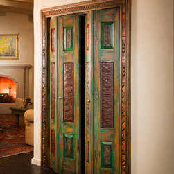 Canyon Road Remodel - The Doors (and a Gate) - Bi-Fold closet doors with surround.  Made with antique carved panels and antique tin.  Photo: Eric Swanson